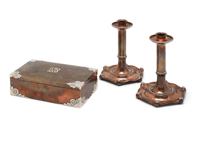 A 20th century silver mounted and copper  box in the arts and craft style; together with a similar pair of candlesticks (3)