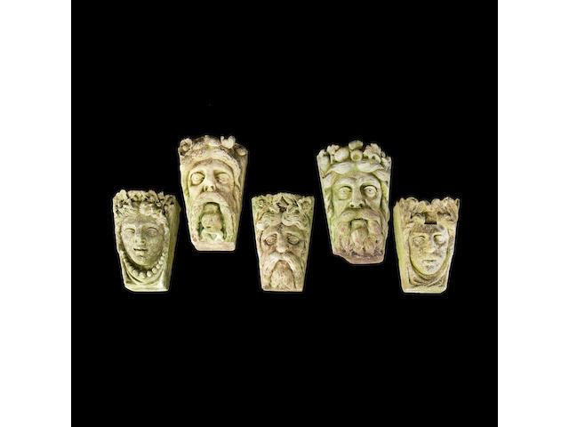 A set of five Victorian Portland stone keystone heads