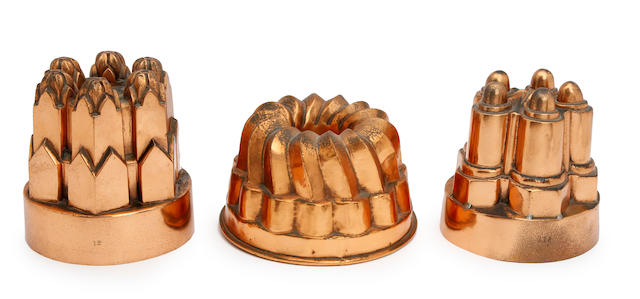 Three large copper jelly moulds (218), (12) and an unnumbered example with small ring handle (3)