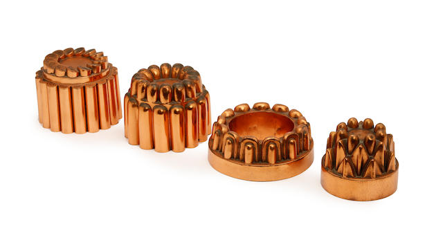 Four copper jelly moulds, one a ring (68), two fluted examples (348) & (301), and an unnumbered example (4)