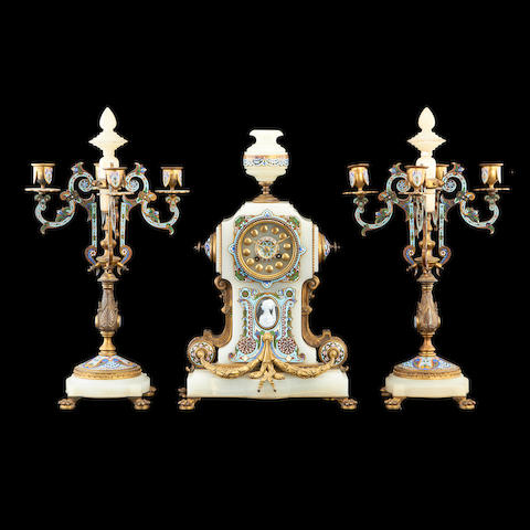 A third quarter 19th century French Algerian onyx, gilt bronze and champlevé enamel clock garnitureby La Compagnie des Marbres et Onyx d'Algérie