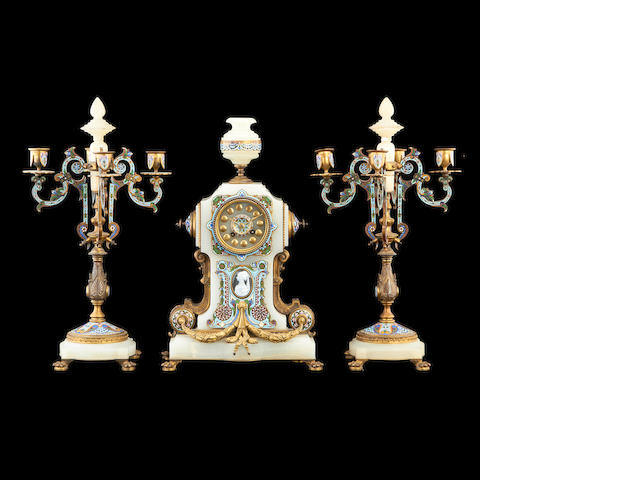 A third quarter 19th century French Algerian onyx, gilt bronze and champlevé enamel clock garniture by La Compagnie des Marbres et Onyx d'Algérie