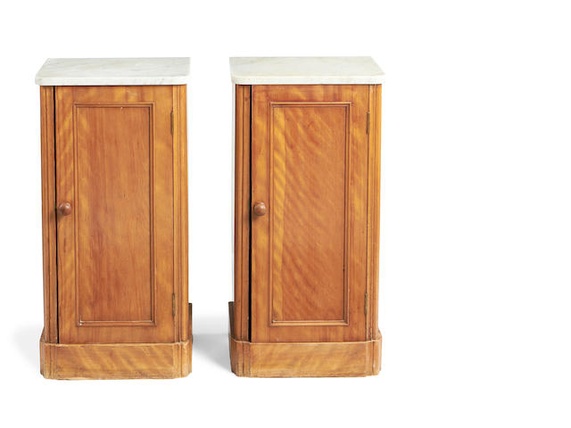 A pair of Victorian satinbirch bedside cupboards