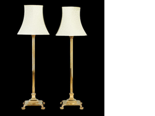 A pair of brass floor standing lamps - Gents