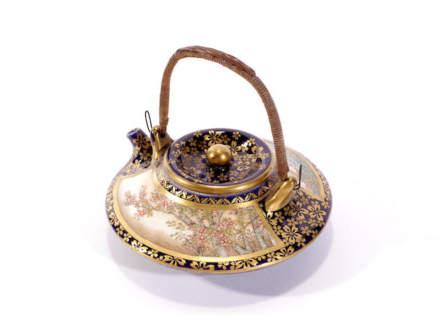 A Japanese Satsuma miniature teapot and cover