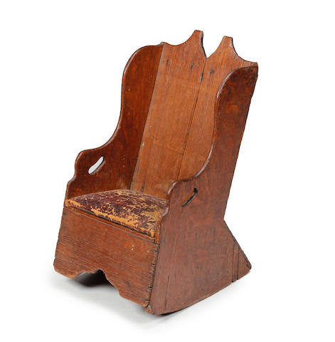 A 19th Century childs oak rocking chair.