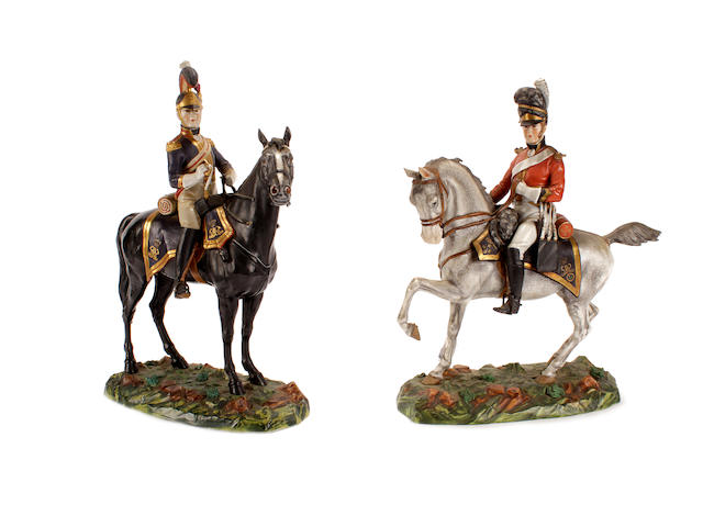 A pair of continental porcelain military equestrian figures, 20th century