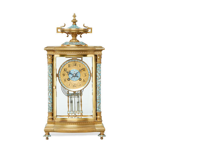 An early 20th century gilt metal and champlevé enamel four glass mantel clock by Japy Freres with original leather case