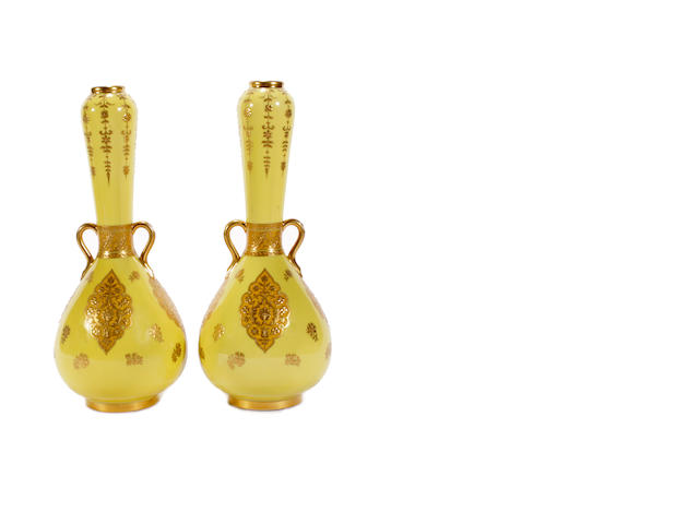 A pair of Minton Persian style vases, dated 1888