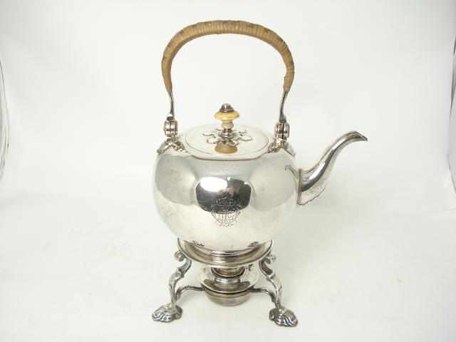 A silver tea kettle with stand  by Goldsmiths & Silversmiths Company, London 1921