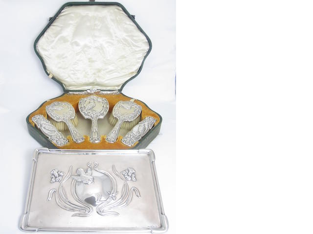A cased silver mounted dressing table set by J Aitkin & Sons,  Birmingham 1903/04/06, the hand mirror maker's mark O & F, Birmingham 1903, registration no. 417544