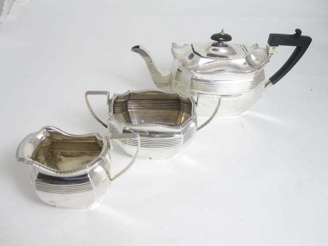 A late Victorian three piece bachelor's silver tea service Sheffield 1912-1915
