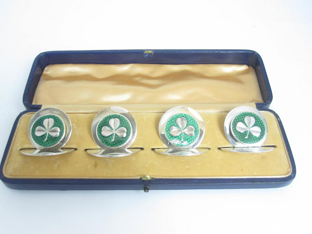 A cased set of four silver and enamelled menu holders retailed by Sampson Mordan, of London, Chester 1906  (damages)