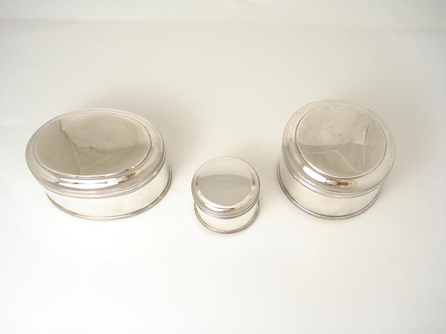 Two mid Victorian Dutch silver collar boxes and a stud box by Van Kempen,    (3)