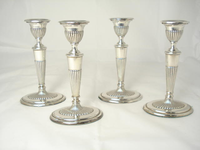 A set of four Continental silver candlesticks marks unclear