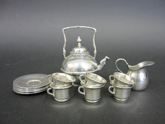 A Dutch silver miniature fourteen piece tea service bearing pseudo marks