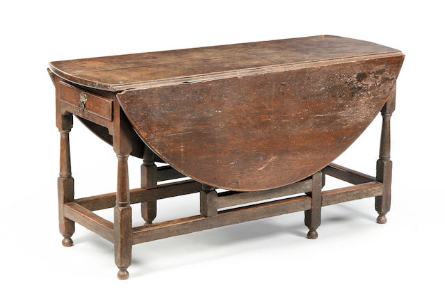 An early 18th century oak gate leg dining table