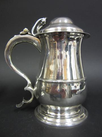 A George III silver lidded baluster tankard by Robert Cox, London 1755