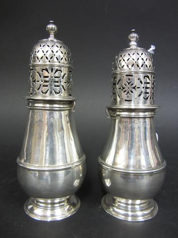 A Queen Anne silver pair of Britannia standard baluster casters by Charles Adam, London 1712