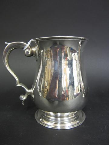 A George II silver baluster mug by William Shaw II & William Priest, London 1759