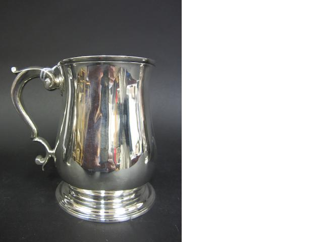 A George II silver baluster mug by Samuel Welles, London 1746