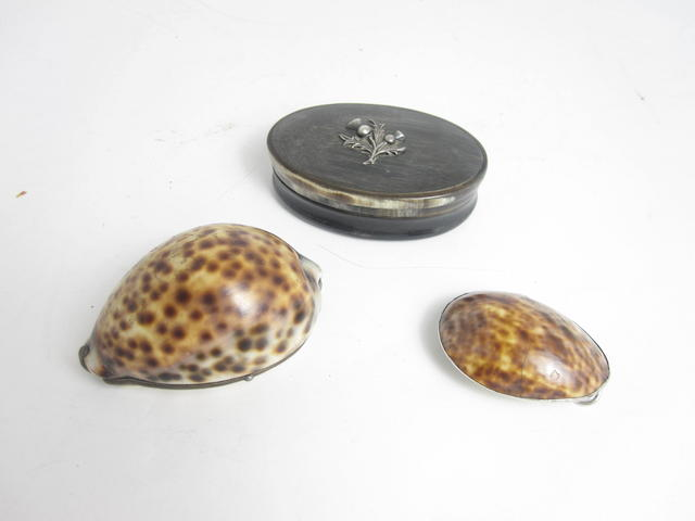 A 19th century cowrie shell snuff mull with makers mark of JL, and with four futher marks possibly fleur-de-lys,  (3)