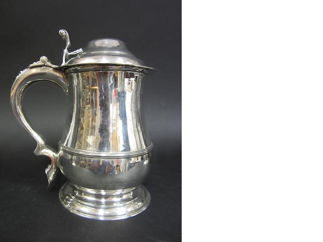 A George II silver lidded baluster tankard  the maker later over struck by Edward Fernall in the late 18th century, London 1738