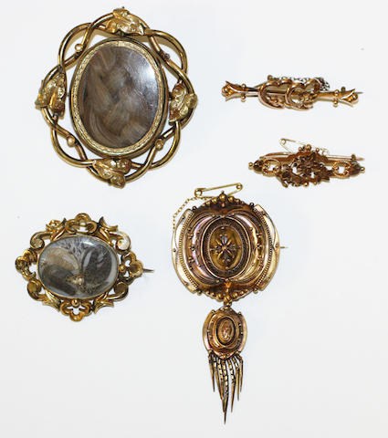 Five brooches,