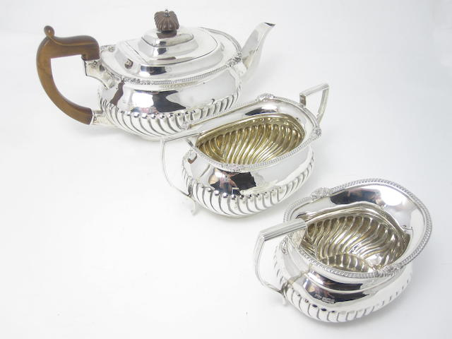 A three piece silver tea service by Mappin & Webb, Sheffield 1901/02