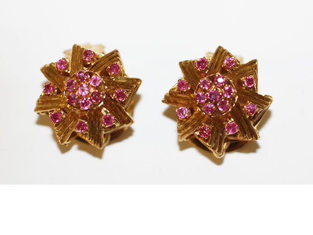 A pair of ruby earclips,
