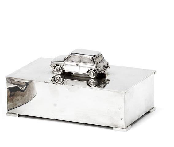 A silver presentation 'Mini' cigarette box, by S J Rose & Son for Asprey, Hallmarked London 1979,