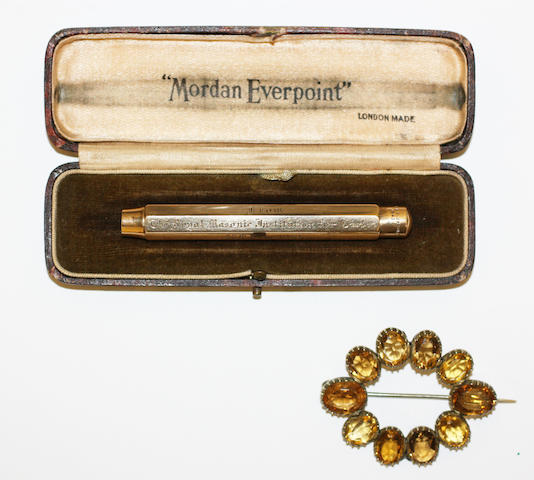 A 9ct gold propelling pencil and a citrine brooch, (2)