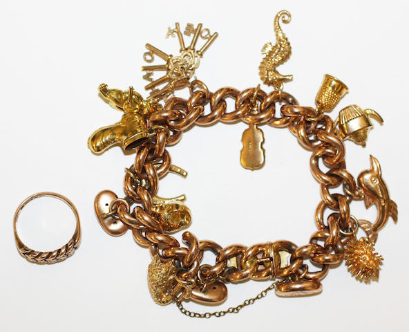 A charm bracelet and a ring, (2)