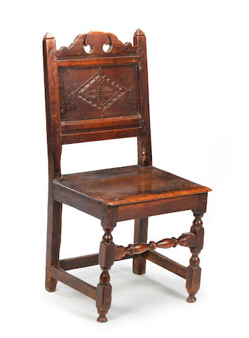 A late 17th century oak back stool North Cheshire