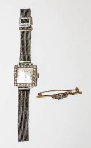 A lady's diamond set wristwatch and a diamond set bar brooch, (2)