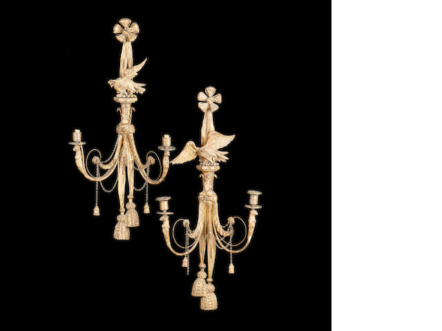 A set of four early 20th century George III style giltwood wall lights