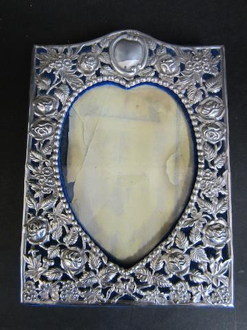 An Edwardian silver pierced photograph frame by Goldsmiths & Silversmiths Co., Ltd., London 1902