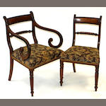 A set of nine George IV mahogany dining chairs