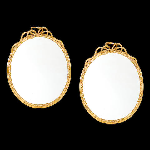 A pair of French late 19th/early 20th century giltwood and composition mirrors in the manner of Fournier