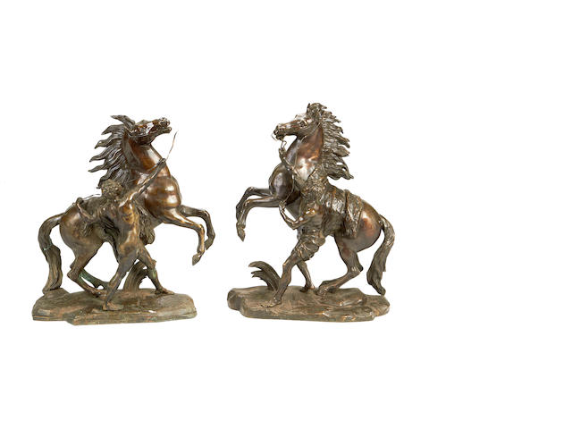After Guillaume Coustou, French (1677-1746) A pair of early 20th century bronze models of the Marley Horses