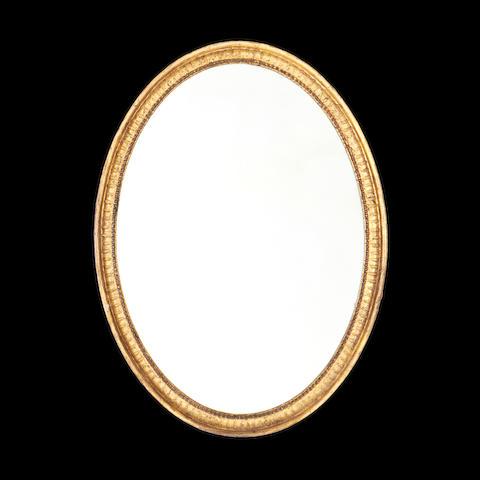 A George III giltwood oval mirror