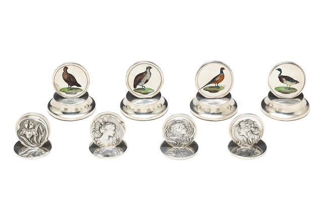 A cased set of four silver Art Nouveau menu holders by Henry Matthews, Birmingham 1905; together with another set of four silver and enamelled menu holders depicting game birds  (8)