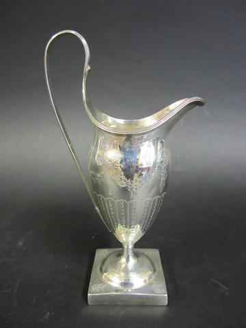 A George III silver baluster bright-cut engraved cream jug by John Lambe, London 1789