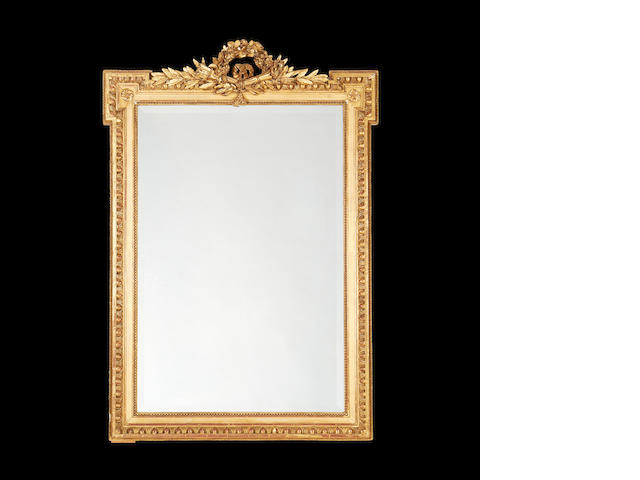 A French late 19th century giltwood mirror  in the Louis XVI style