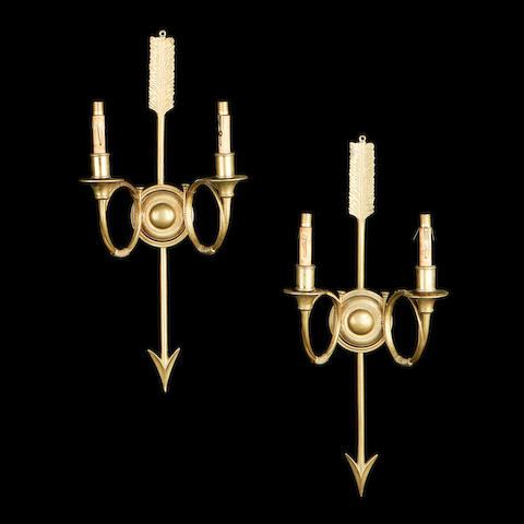 A pair of early 20th century French gilt metal wall lights
