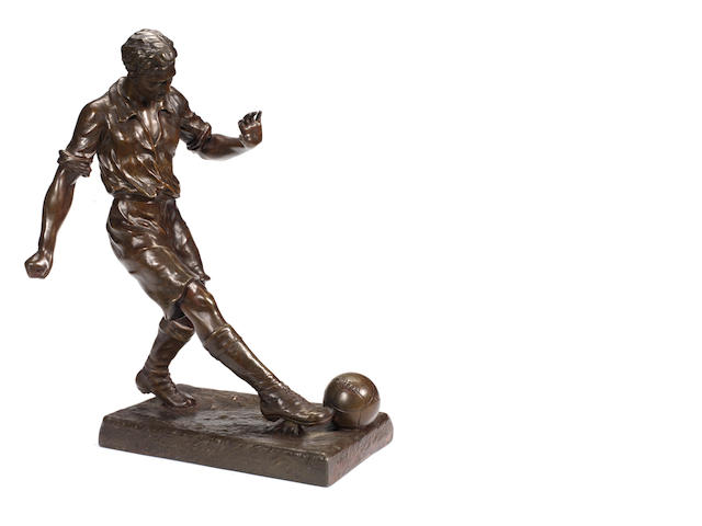 A large 20th century copper-clad figure of a footballer