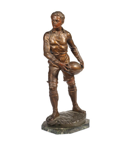 A spelter figure of a rugby player 20th century,