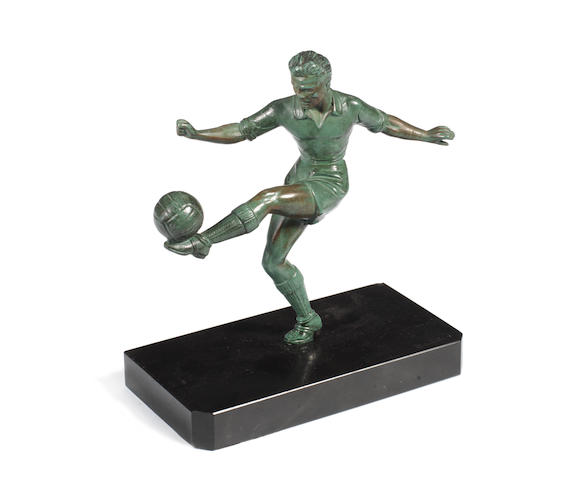 A 20th century bronze figure of a footballer