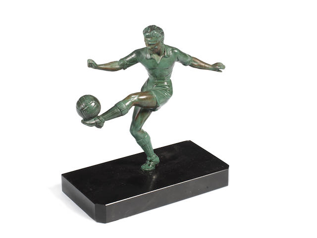 A bronze figure of a footballer,  20th century,