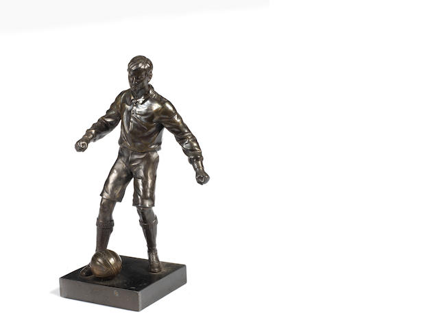 A small spelter figure of a footballer,  20th century,